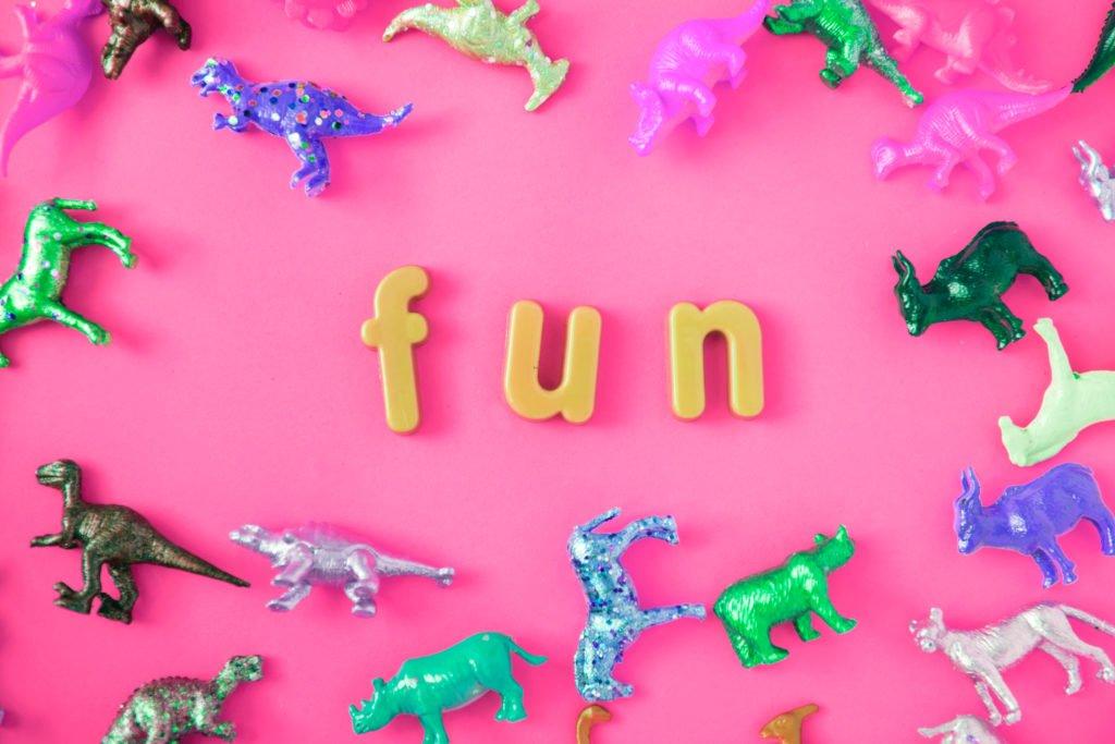 the word fun with various animal toys spread around it