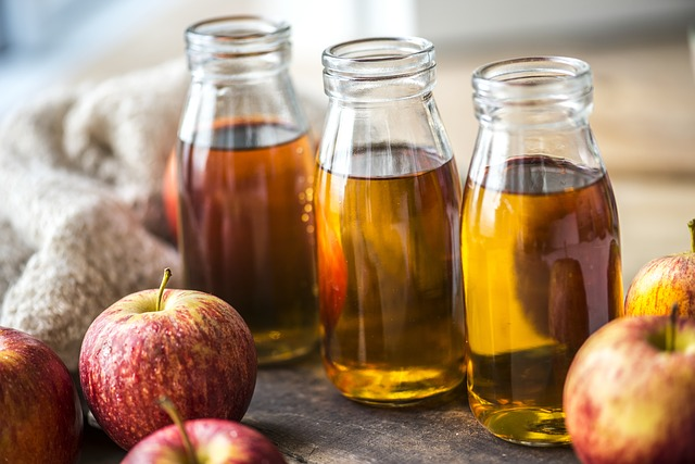 apple cider vinegar in glass bottles