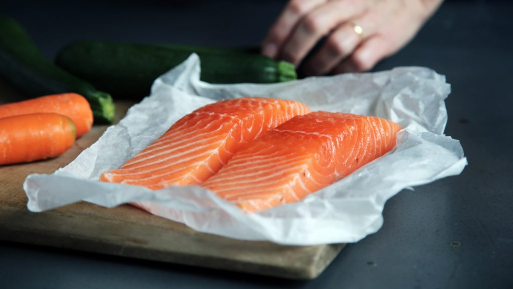 sliced fresh salmon on a wooden board