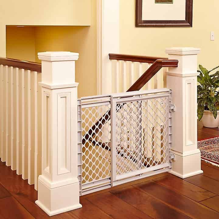 pet safe baby gate installed at the top of stairs